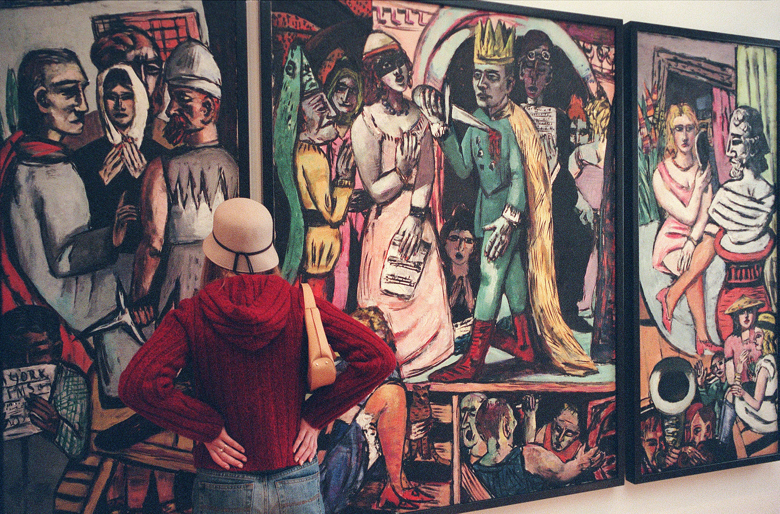 "A patron views Max Beckmann's ""The Actors"" at the Busch-Reisinger Museum."