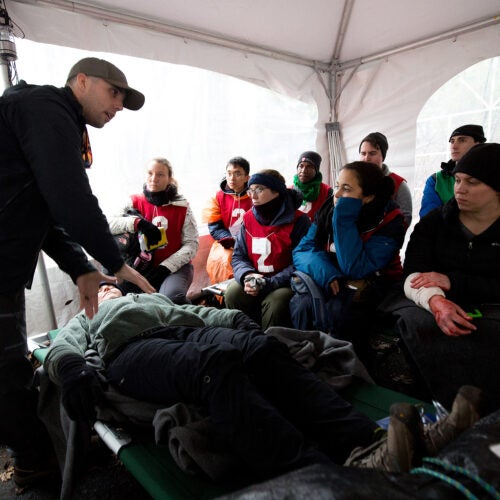 Participants learn to treat injuries in a humanitarian disaster simulation.