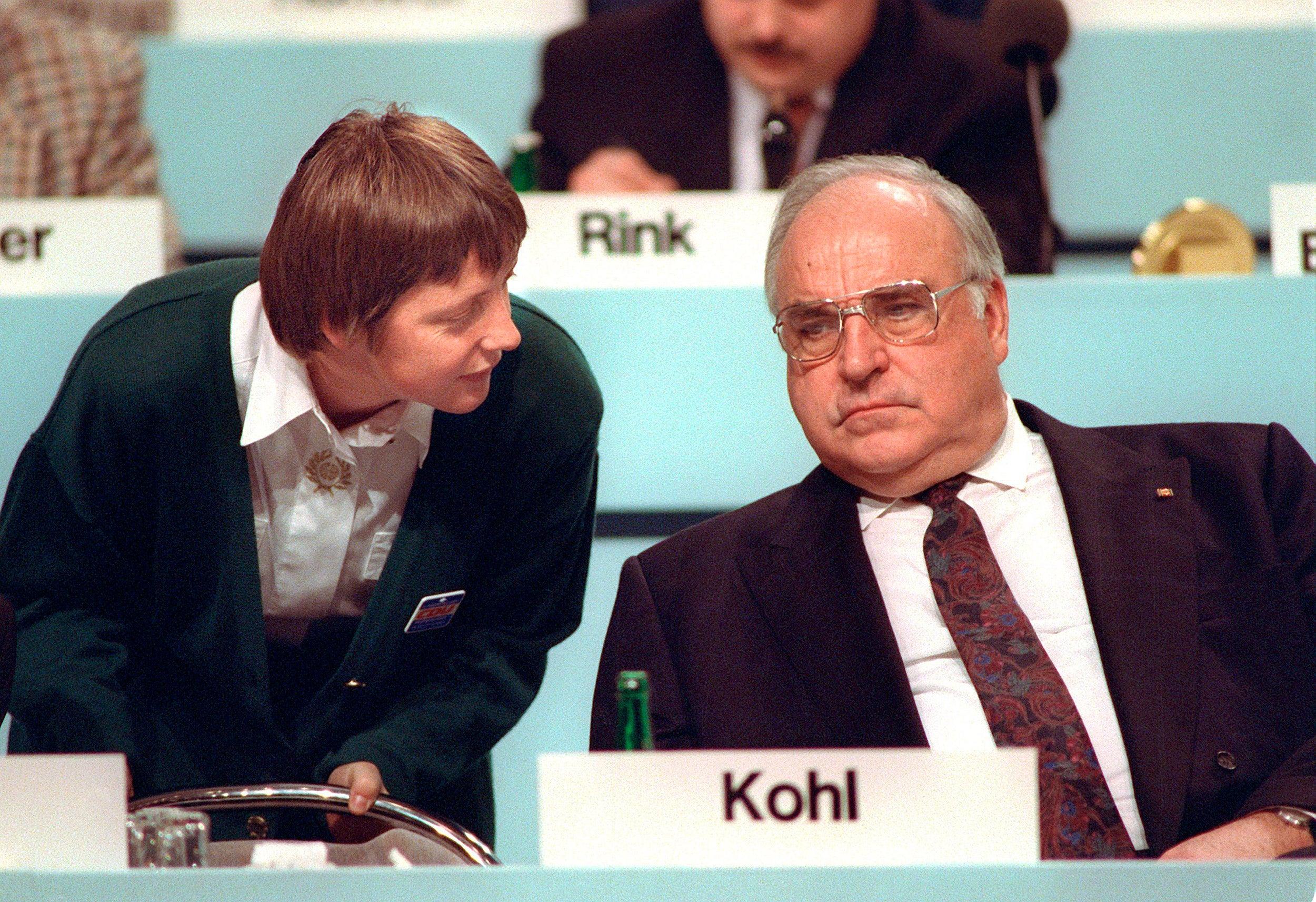 Angela Merkel talks to her mentor, Chancellor Helmut Kohl, in 1991.