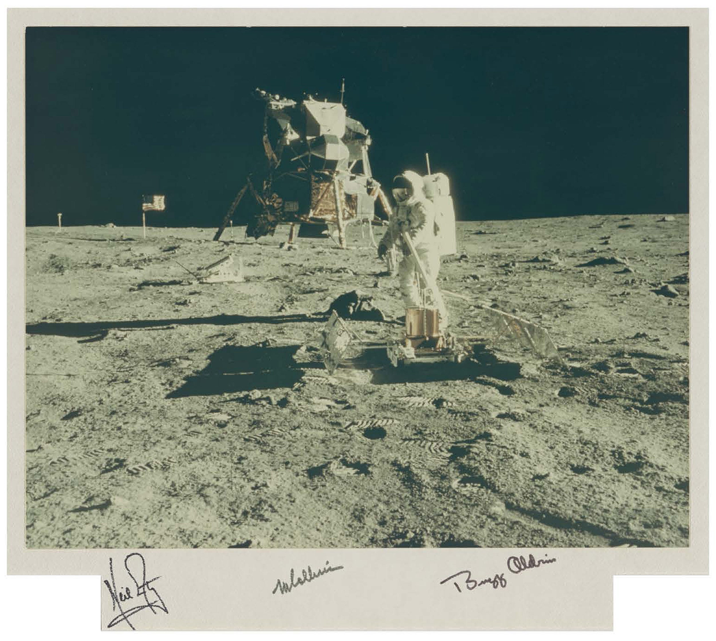 Buzz Aldrin deploys a seismometer to detect moonquakes and meteoroid impacts.