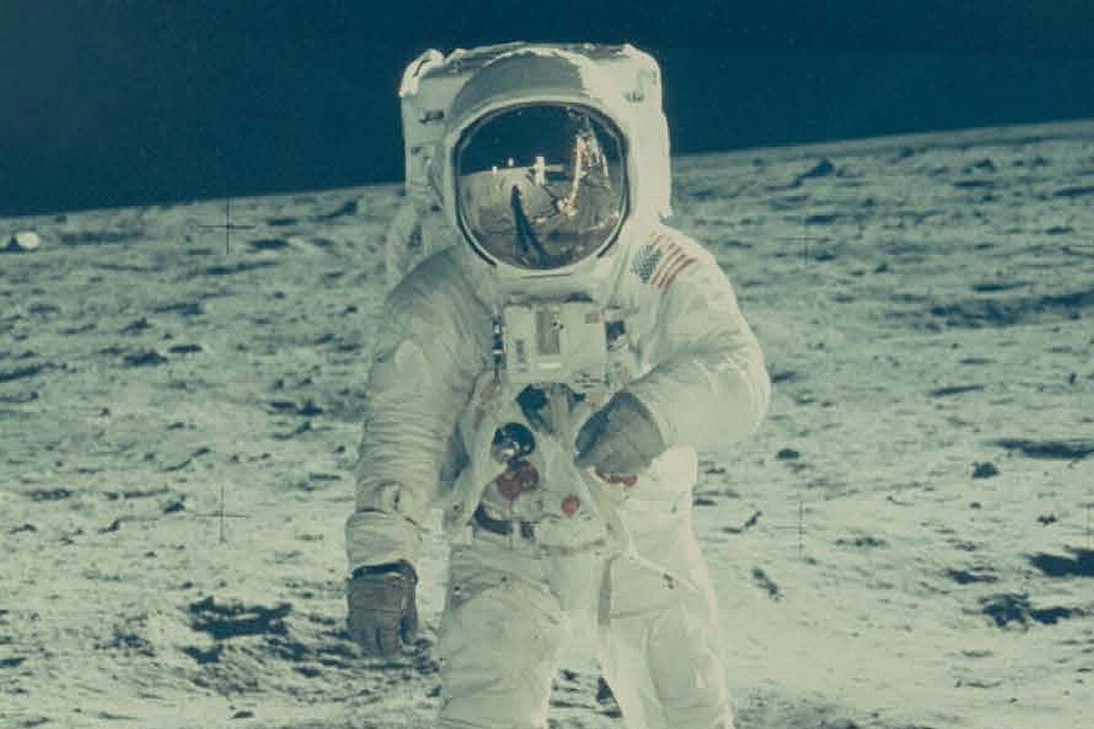 Buzz Aldrin on the moon with Neil Armstrong reflected in his visor.