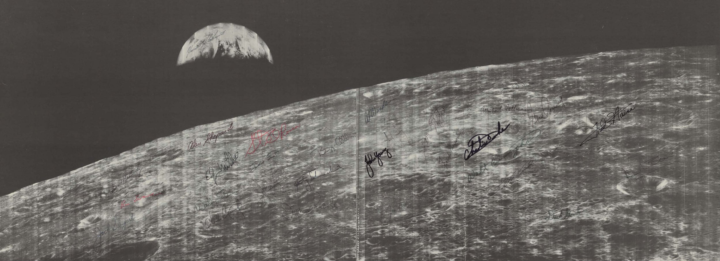 The first image of Earth from deep space, taken by Lunar Orbiter 1 on Aug. 23, 1966, signed by astronauts.