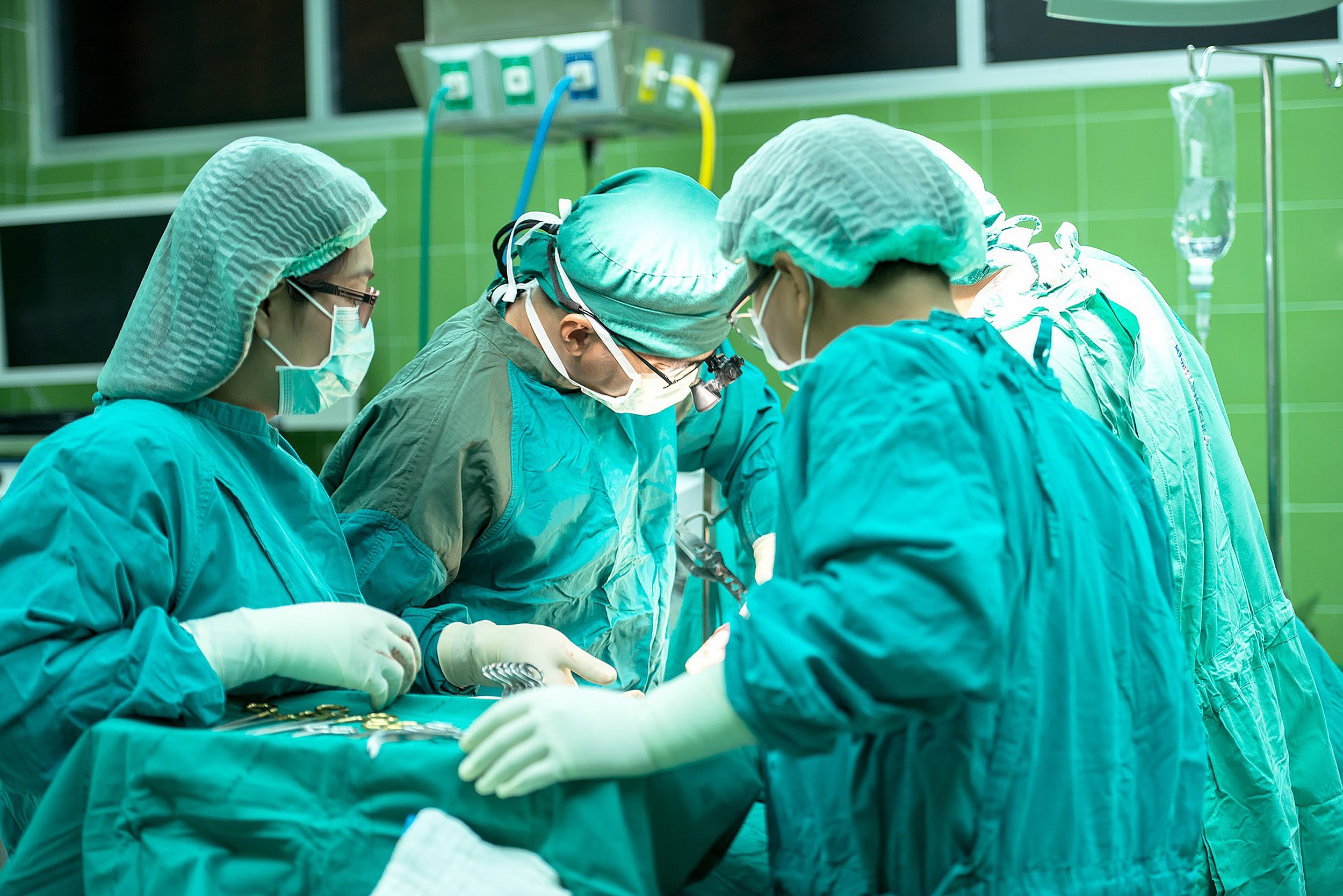 Surgeons performing an operation