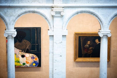 Works by Kerry James Marshall and Nicolas Régnier viewed through archways at Harvard Art Museums.