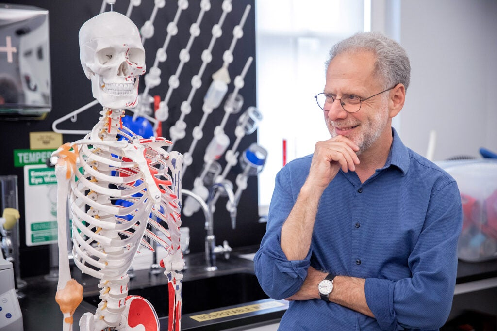 Professor Daniel Lieberman standing in his lab.