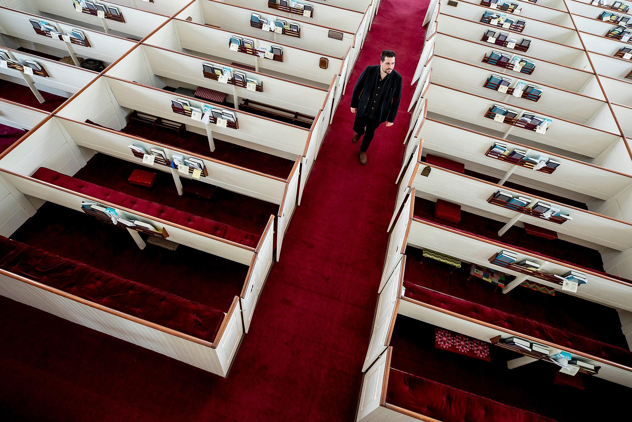 Israel Buffardi walks down the aisle of the church where in interns.
