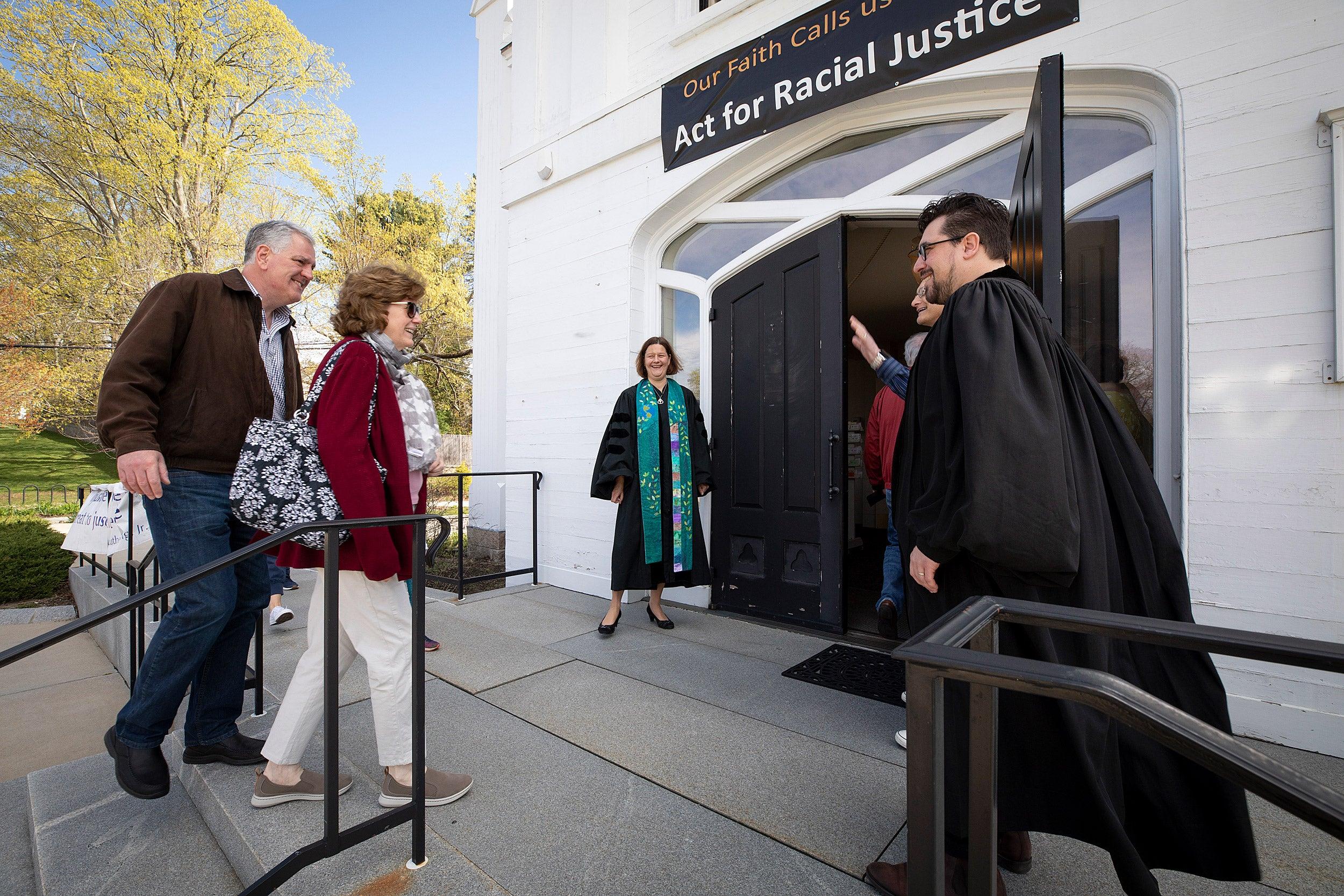 Israel Buffardi greets congregants entering church.