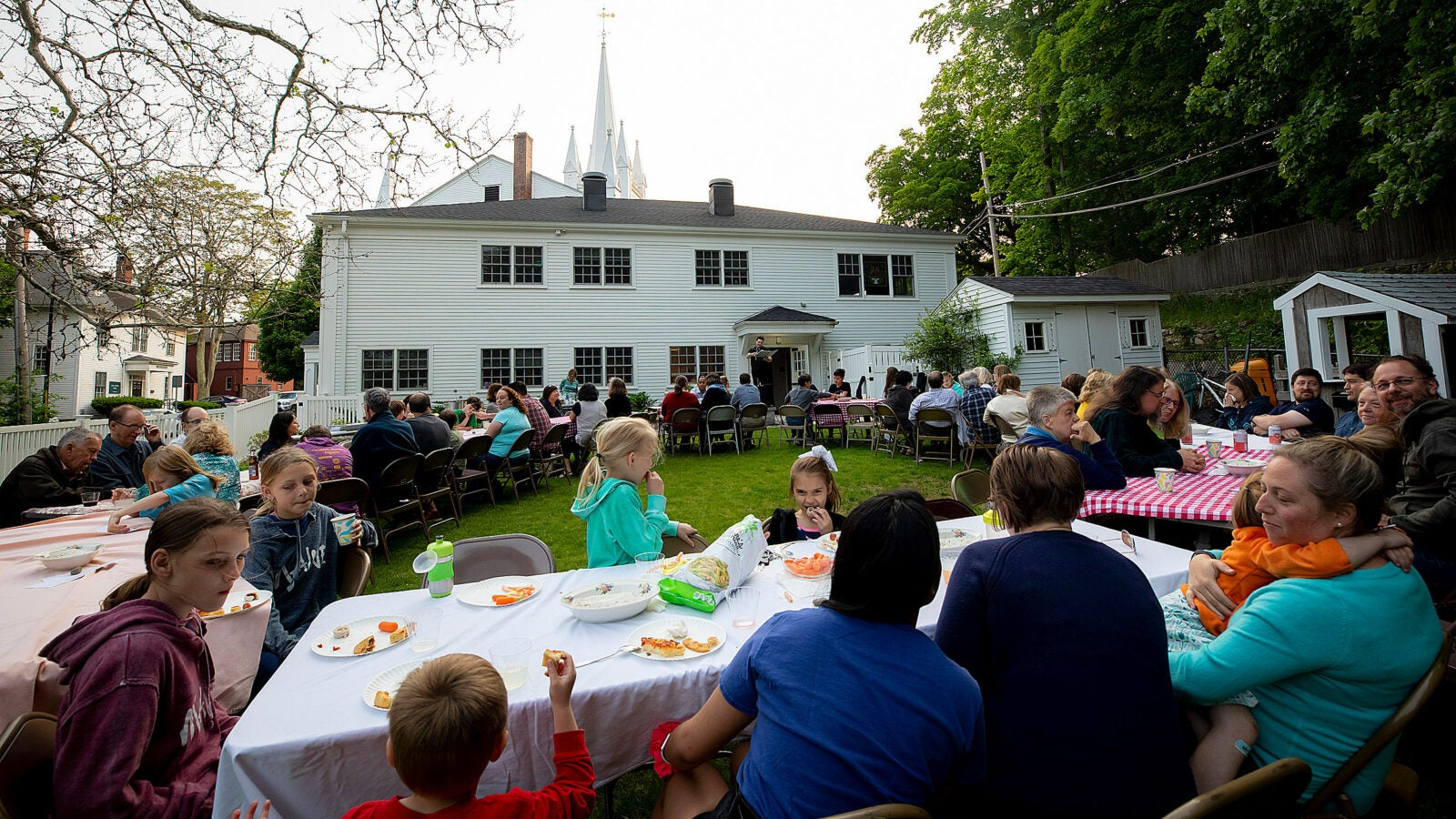 "The congregation of North Andover Unitarian Universalist holds a ""Sacred Supper"" outside the church."