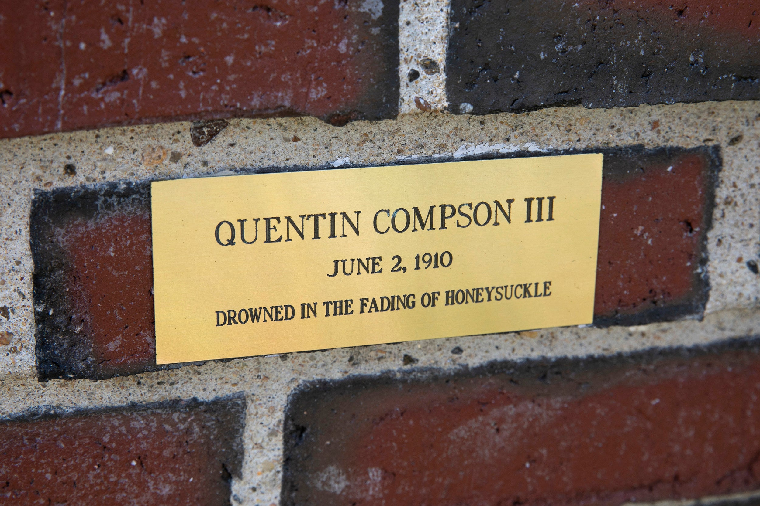 Plaque on a brick wall