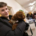 Man holding small dog