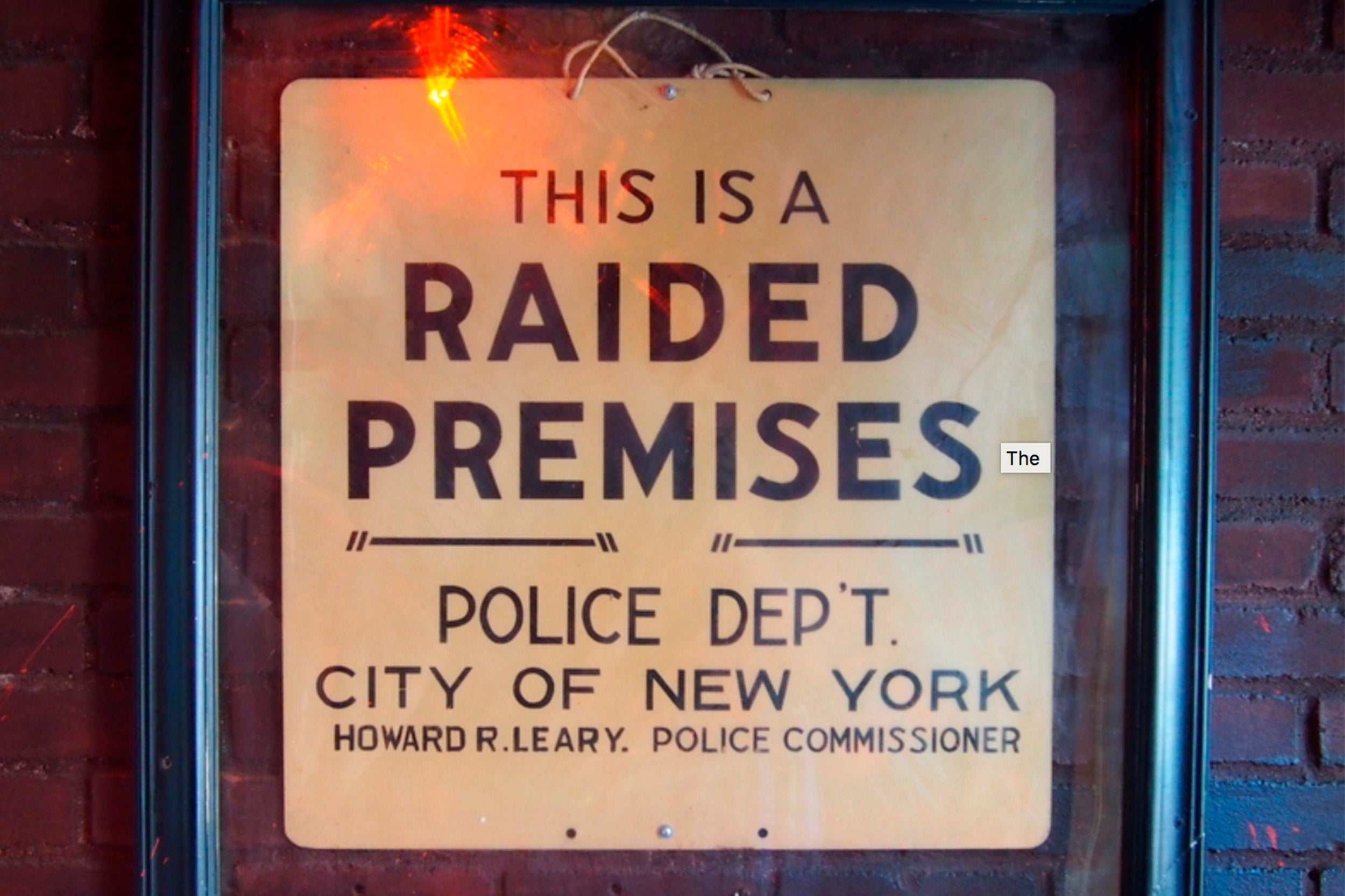 "The ""raided premises"" sign just inside the door at the Stonewall Inn."