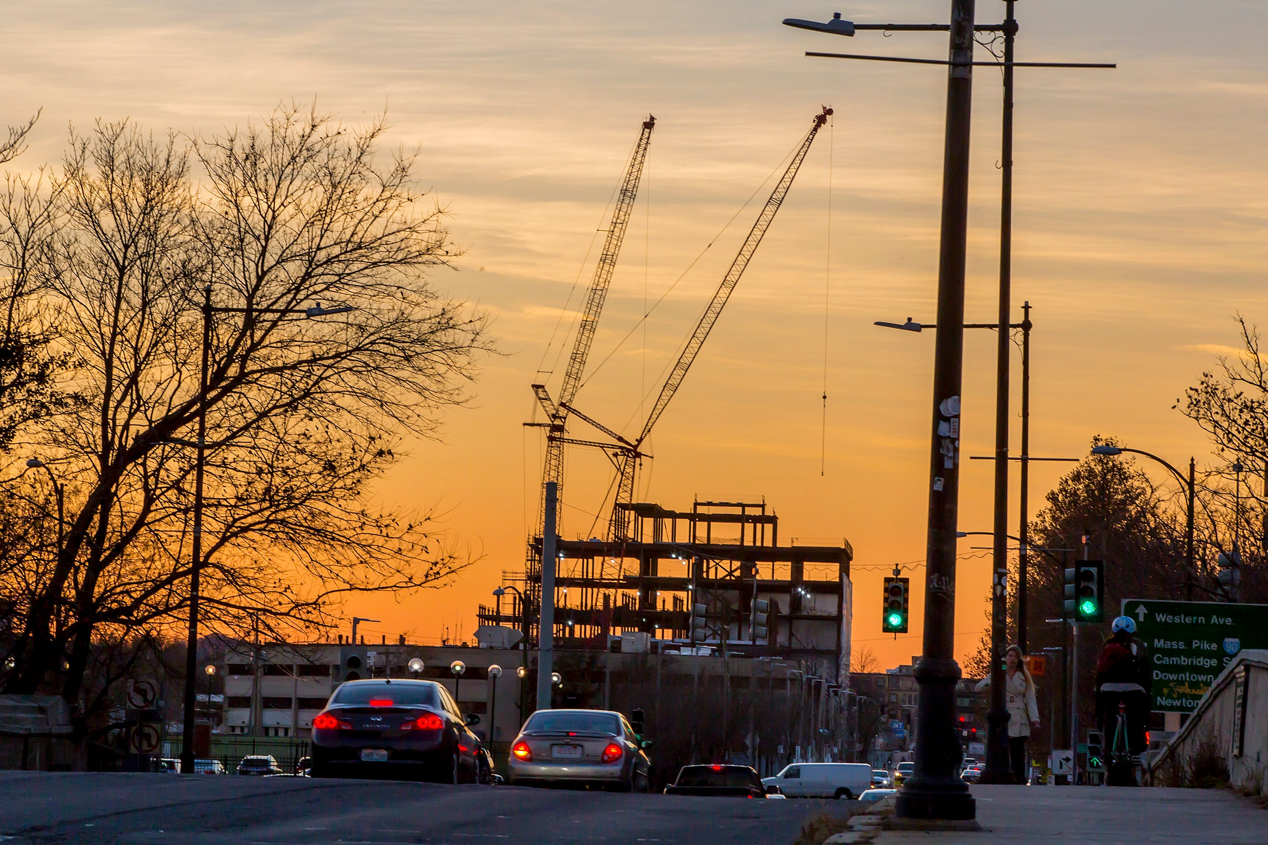 Building under construction in front of a sunset