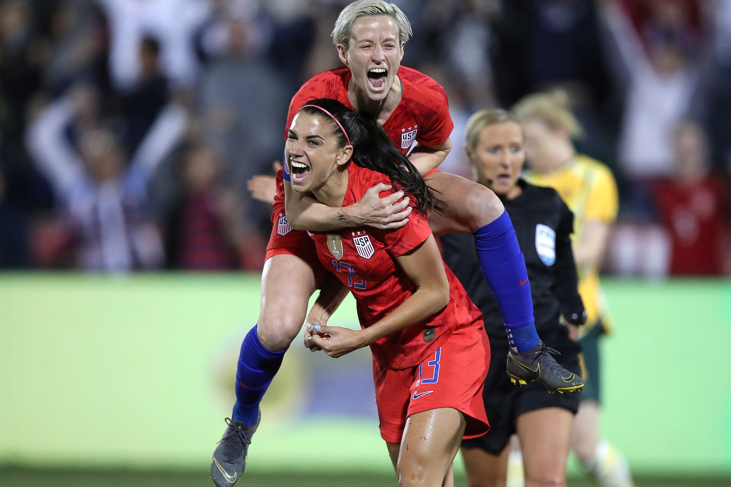 U.S. forward Alex Morgan (front) celebrates scoring her 100th goal with teammate Megan Rapinoe.