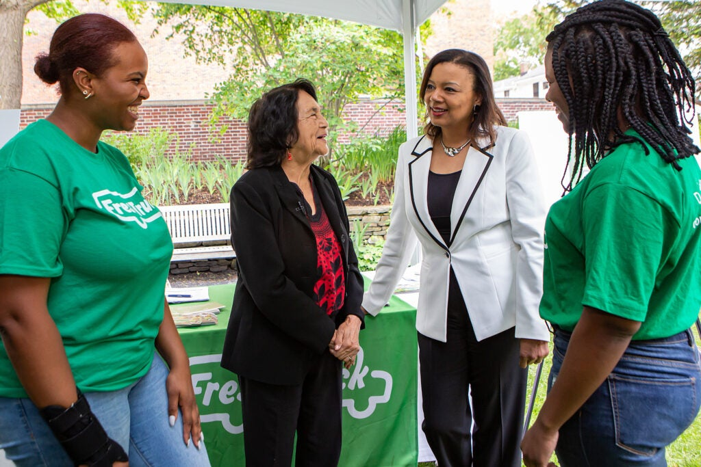 Dolores Huerta and Radcliffe Dean Tomiko Brown-Nagin are flanked by Fresh Truck's Raya Jackson (left) and Markiesha Duverneau.