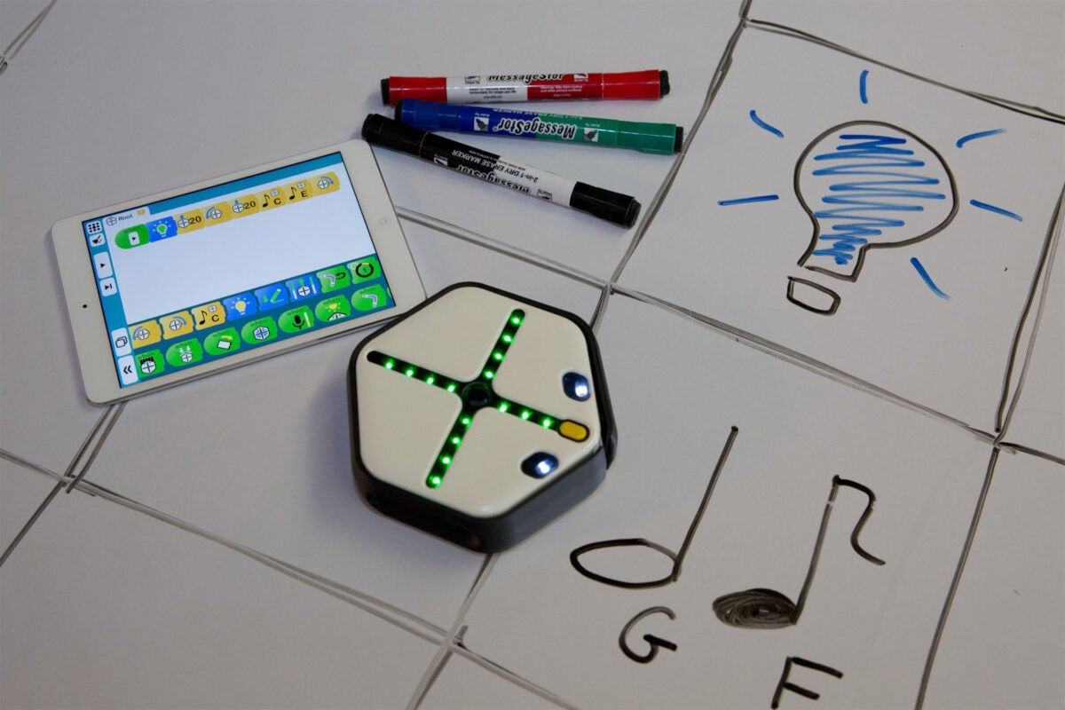 The Root robot with a whiteboard and iPad
