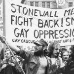 Fighting gay oppression sign in march after Stonewall uprising in 1969.