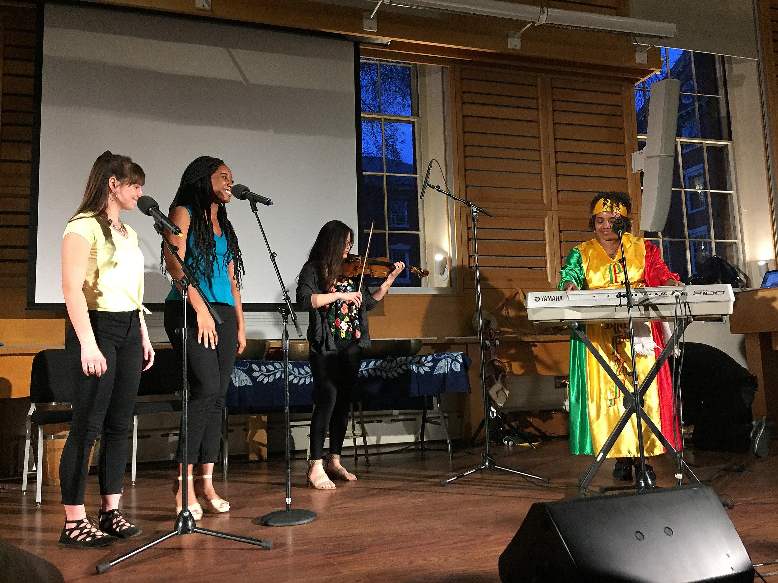 Students performing with Bethlehem Melaku