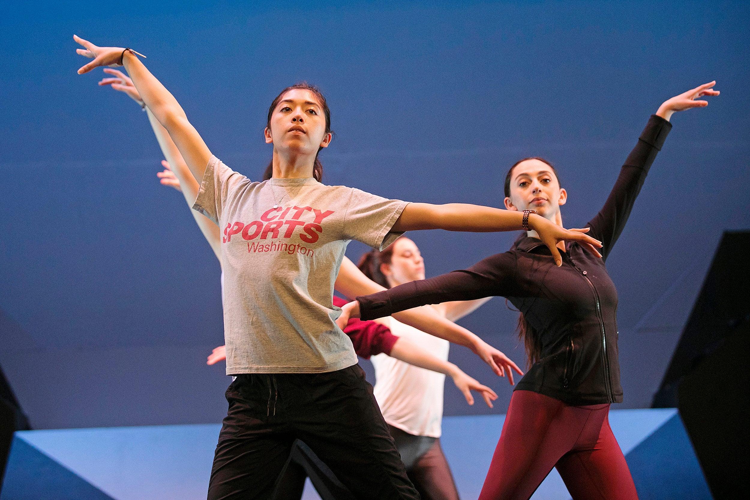 Dancers practice upper-body positions.