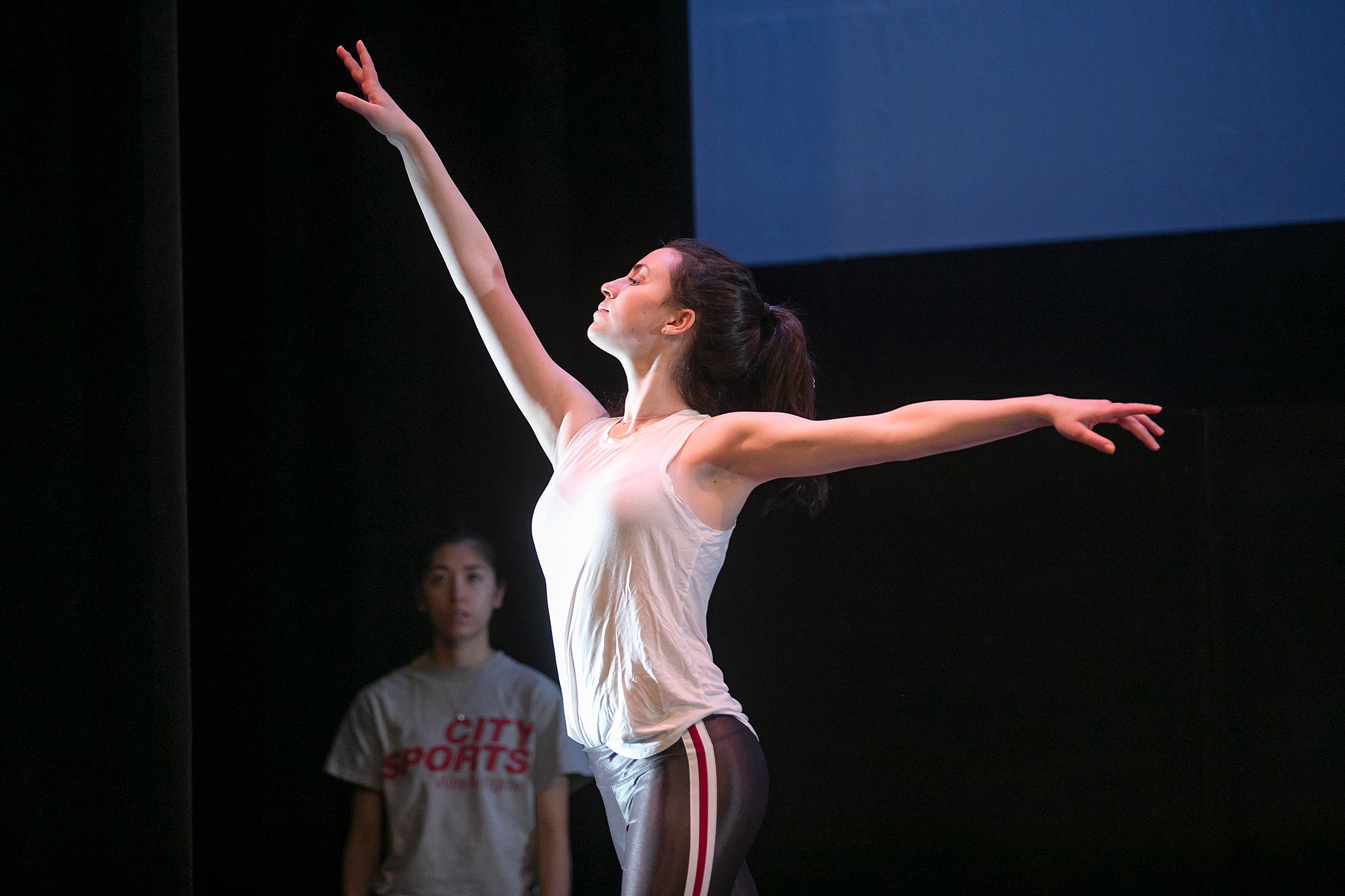 Isabelle Jaffe holds her arms out at different angles.