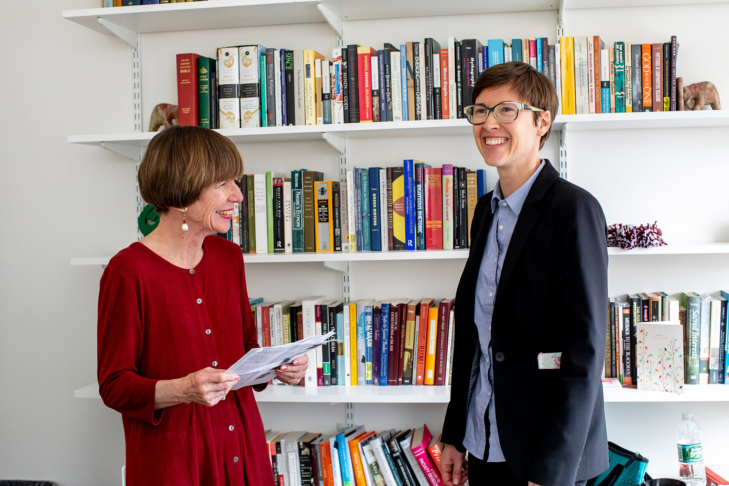 Kathleen Coleman (left) and Eleanor Finnegan chat in front of a bookcase