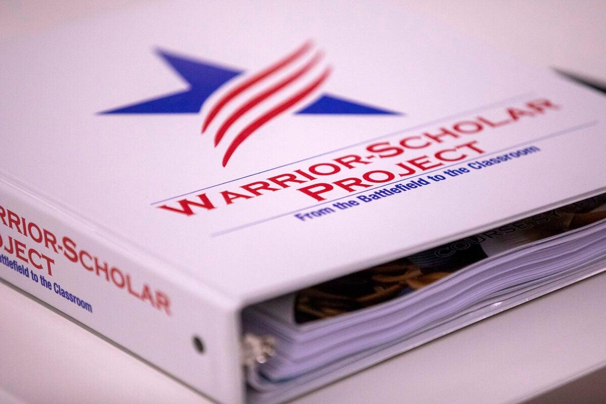 Binder with Warrior-Scholar Project logo