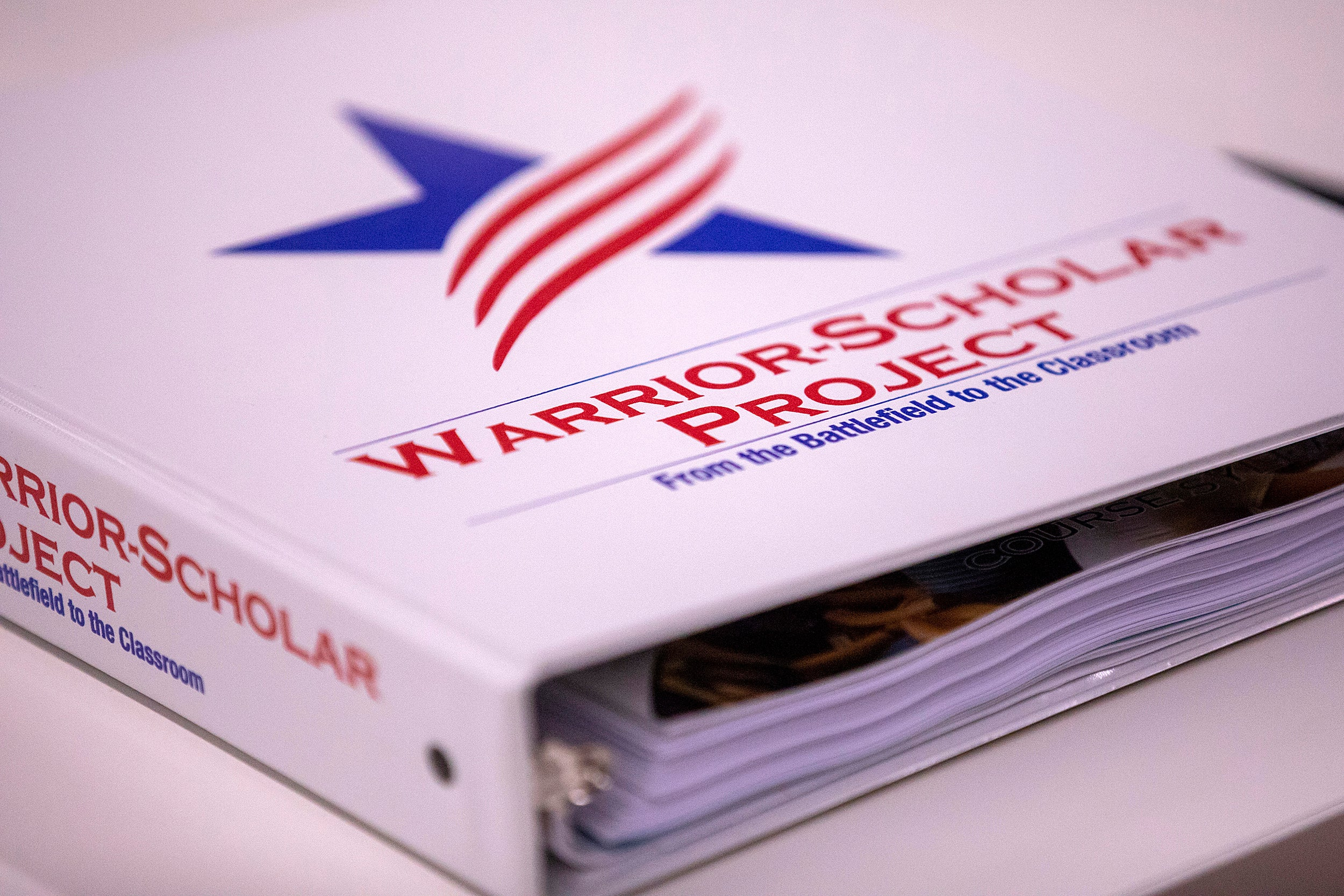 Binder with Warrior-Scholar Project logo