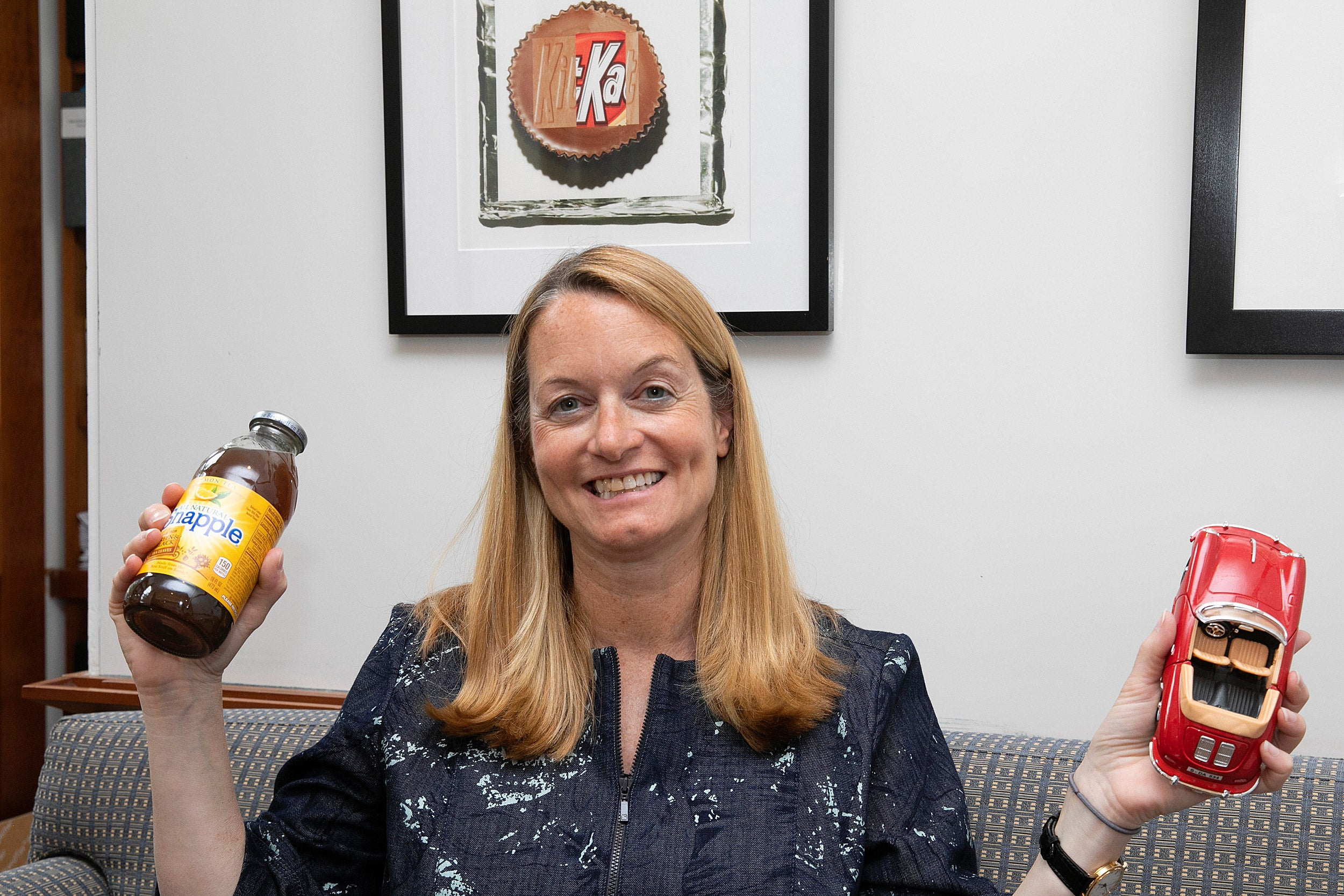 Jill Avery holds a toy car and a bottle of Snapple.