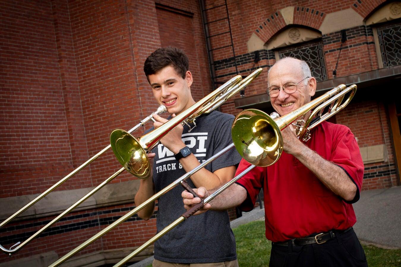 Andrew Yatsushashi, plays trombone as does, David Schwartz.