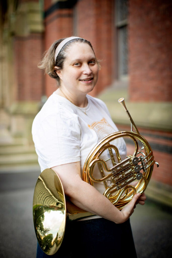 Jill Smith plays the French Horn in the band.
