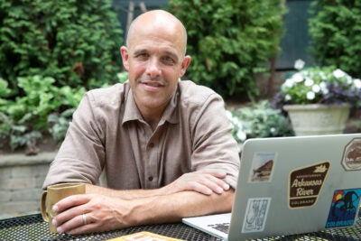 Pieter Cohen sitting in front of a laptop