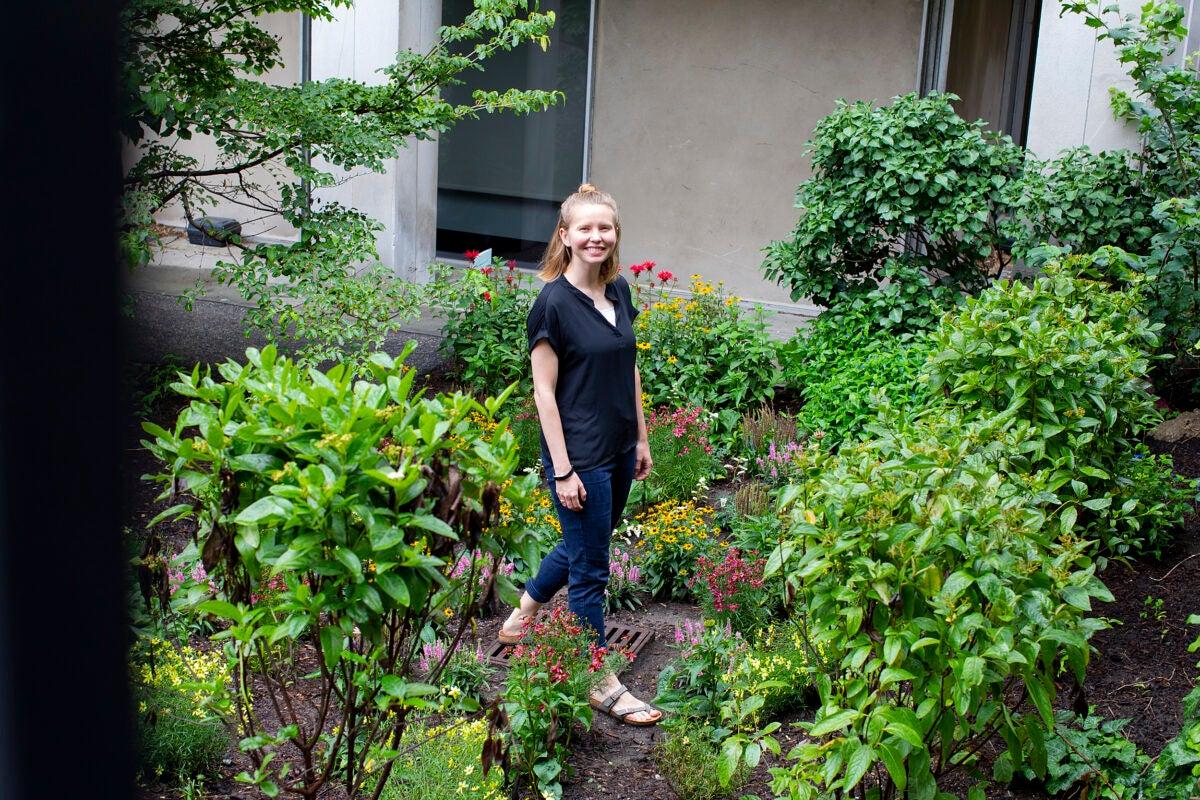 Tia Akins in the rain garden