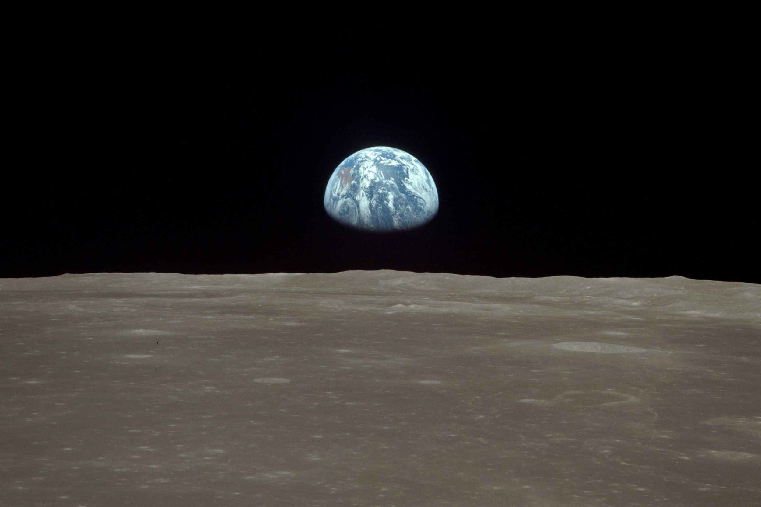 Earthrise viewed from lunar orbit.