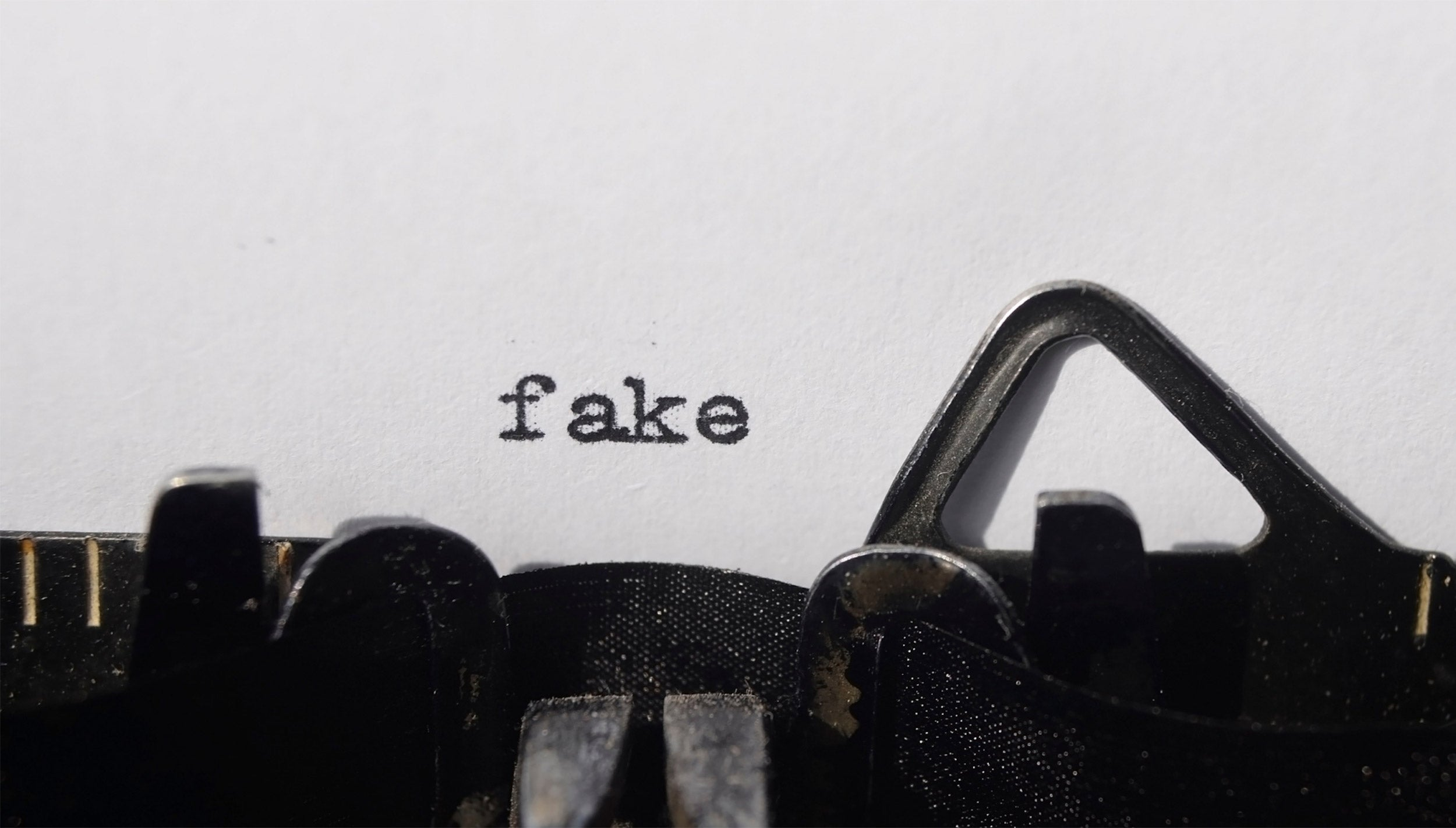 Typewriter with word fake typed out