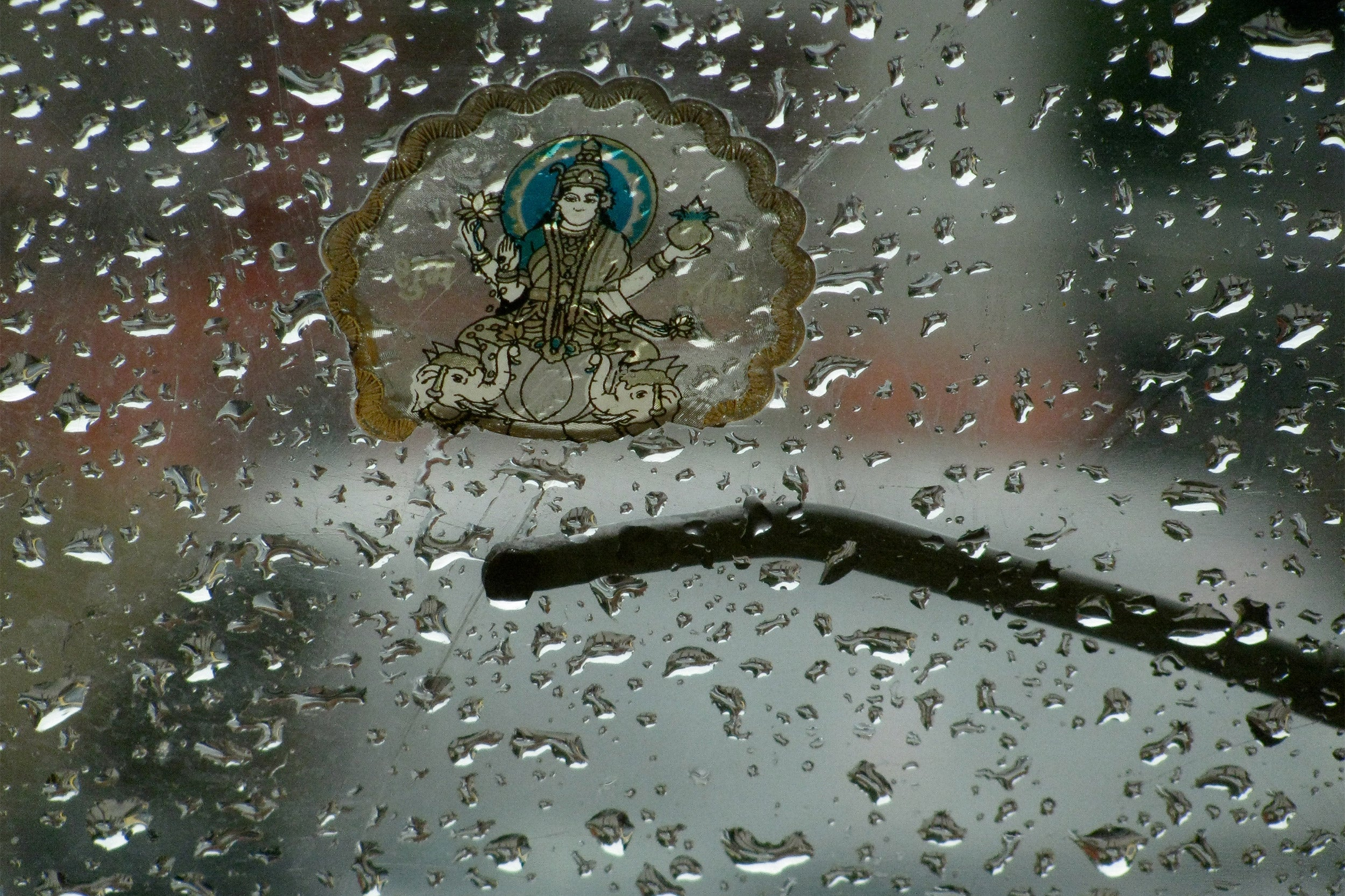 Images of raindrops on a windshield in India