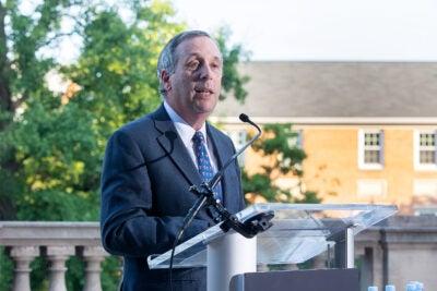 Harvard President Larry Bacow speaking in Washington, D.C.
