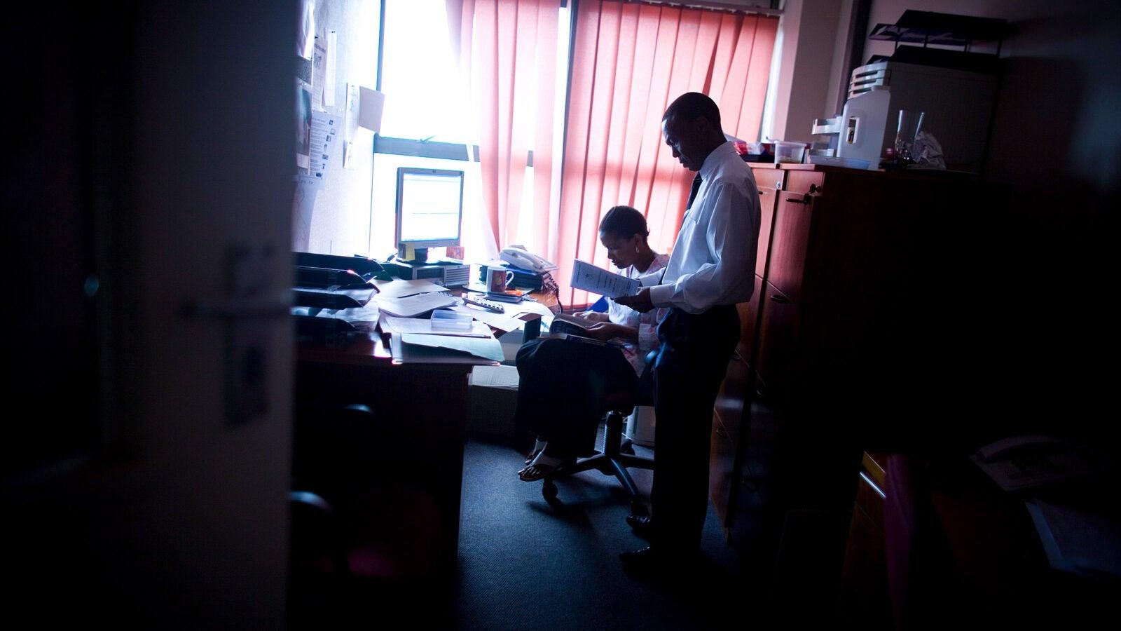 Joseph Makhema speaks with an assistant at the Botswana-Harvard HIV Reference Laboratory in Gaborone, Botswana.