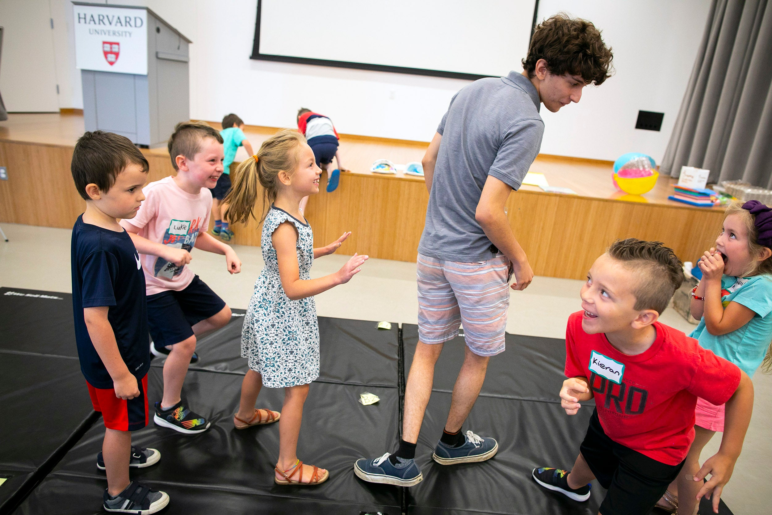 James DiSandro plays with children during acting class.