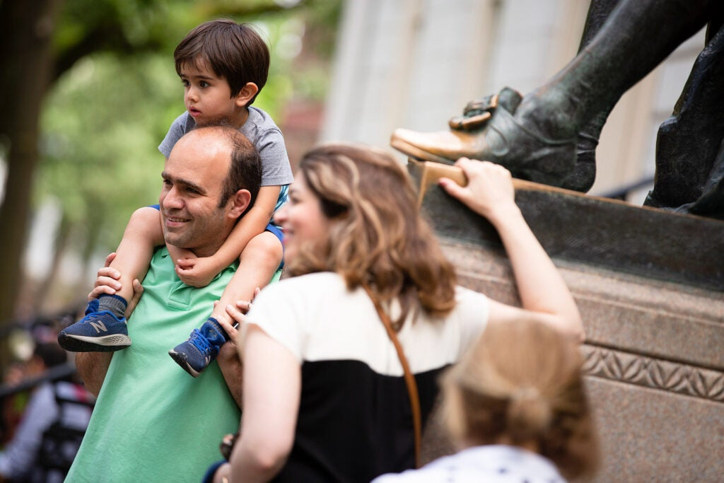A family from Tehran poses by the statue.
