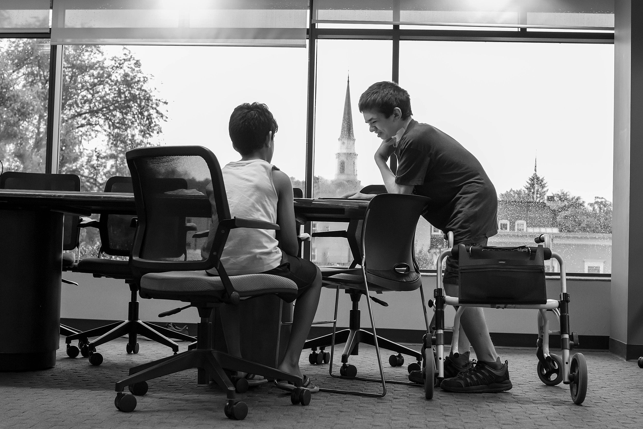 Ben Elwy works with an elementary school student in the library