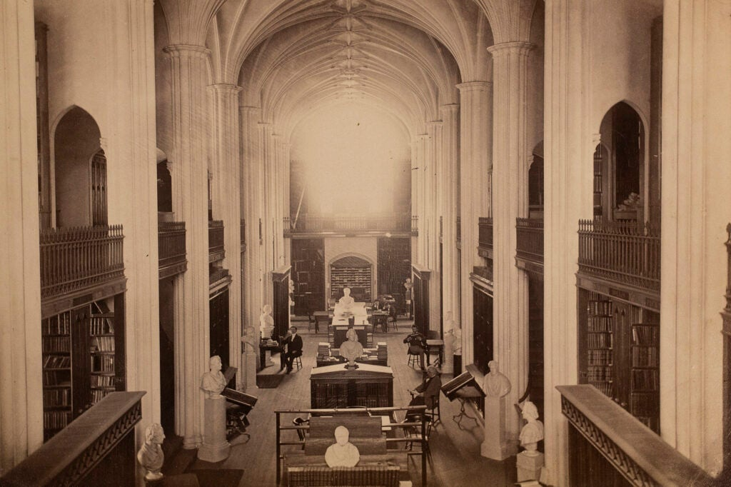 Inside Gore Library, columns and arches resemble church cathedral.
