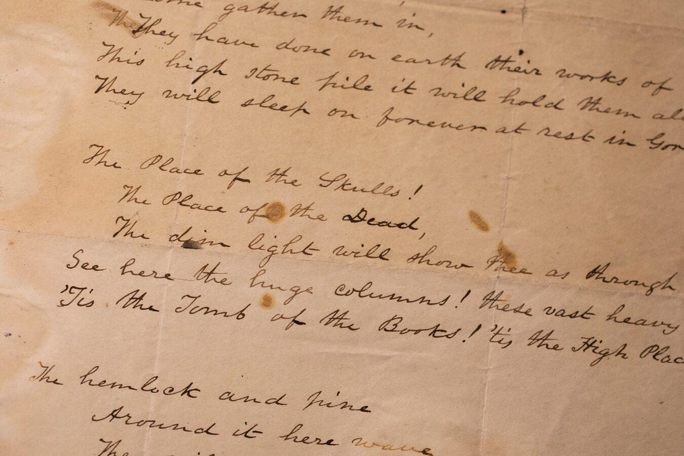 Yellowed page with handwritten verse.