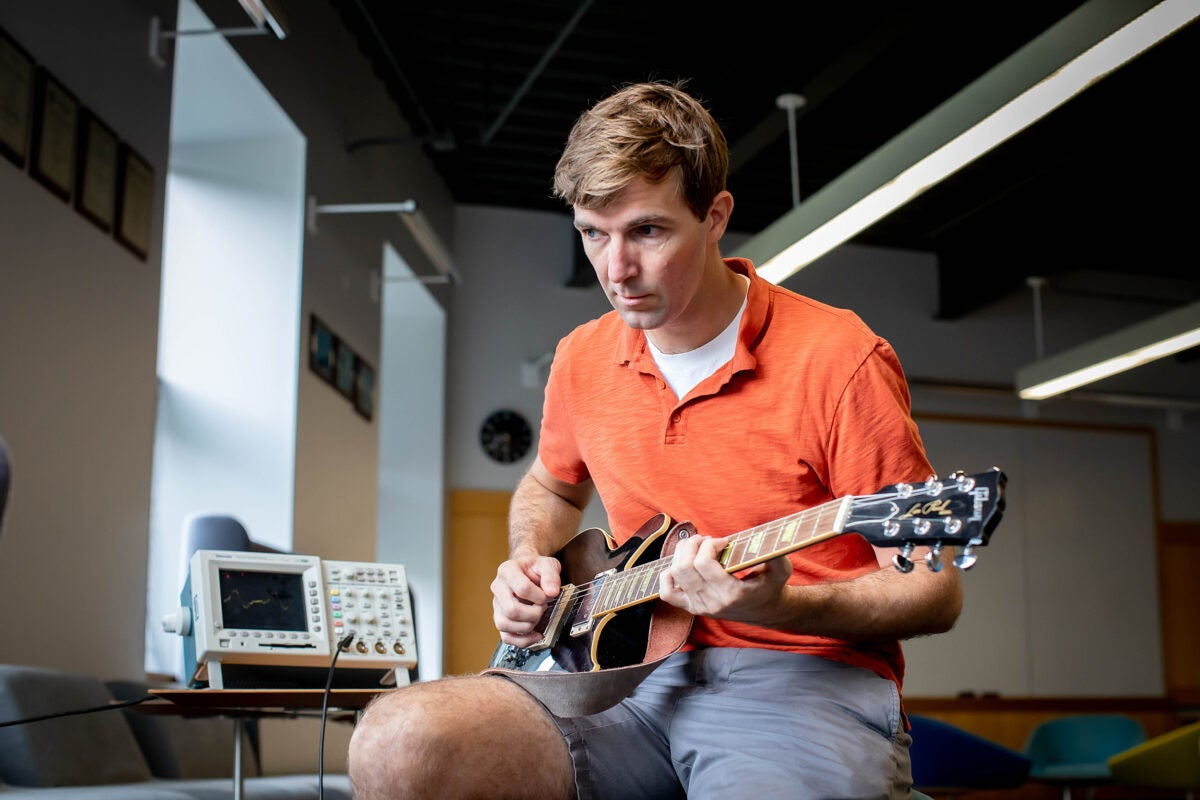 Robert Wood playing guitar