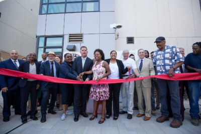 Community leaders including Harvard President Larry Bacow and Boston Mayor Martin J. Walsh celebrated the ribbon-cutting for the first phase of Bartlett Station in Roxbury Thursday