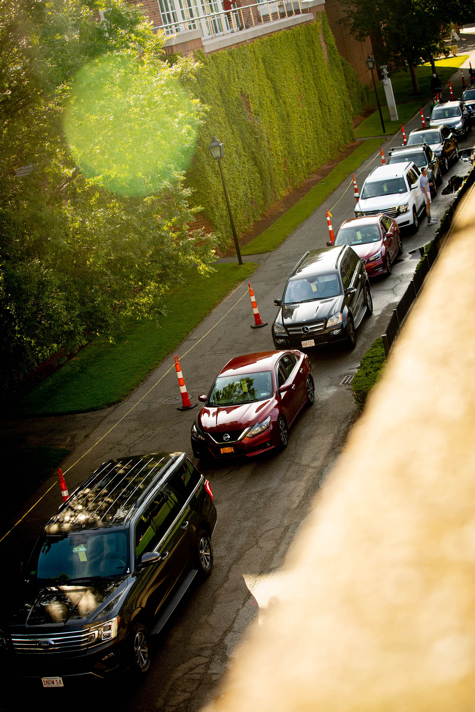 Cars are lined up at the Harvard stadium as first-year students move in to Harvard University
