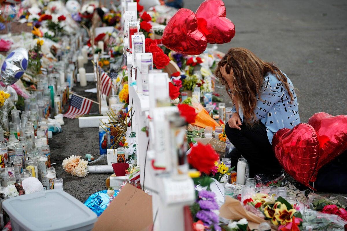 Woman mourns at memorial
