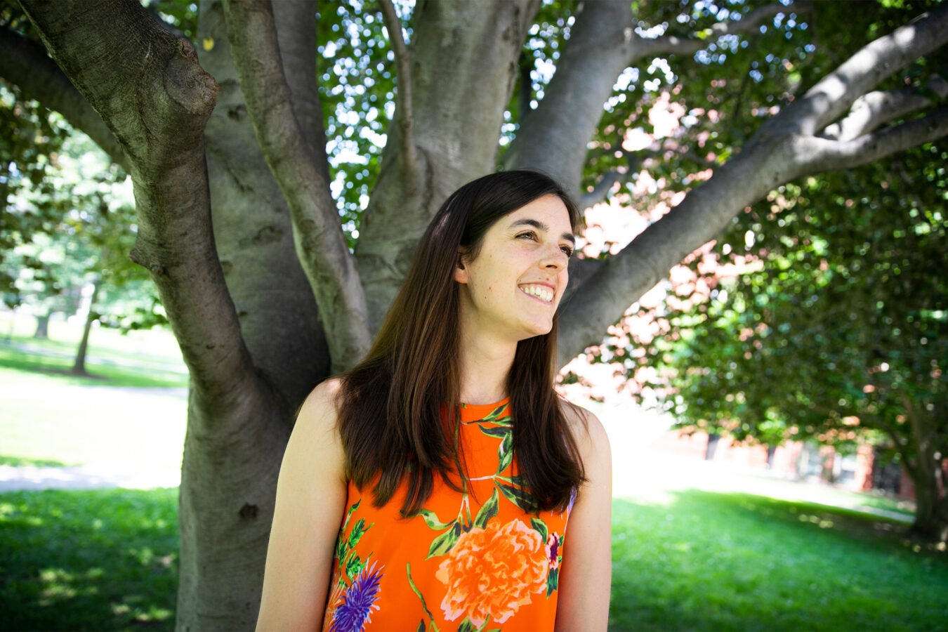 Dakota McCoy outside by a tree.