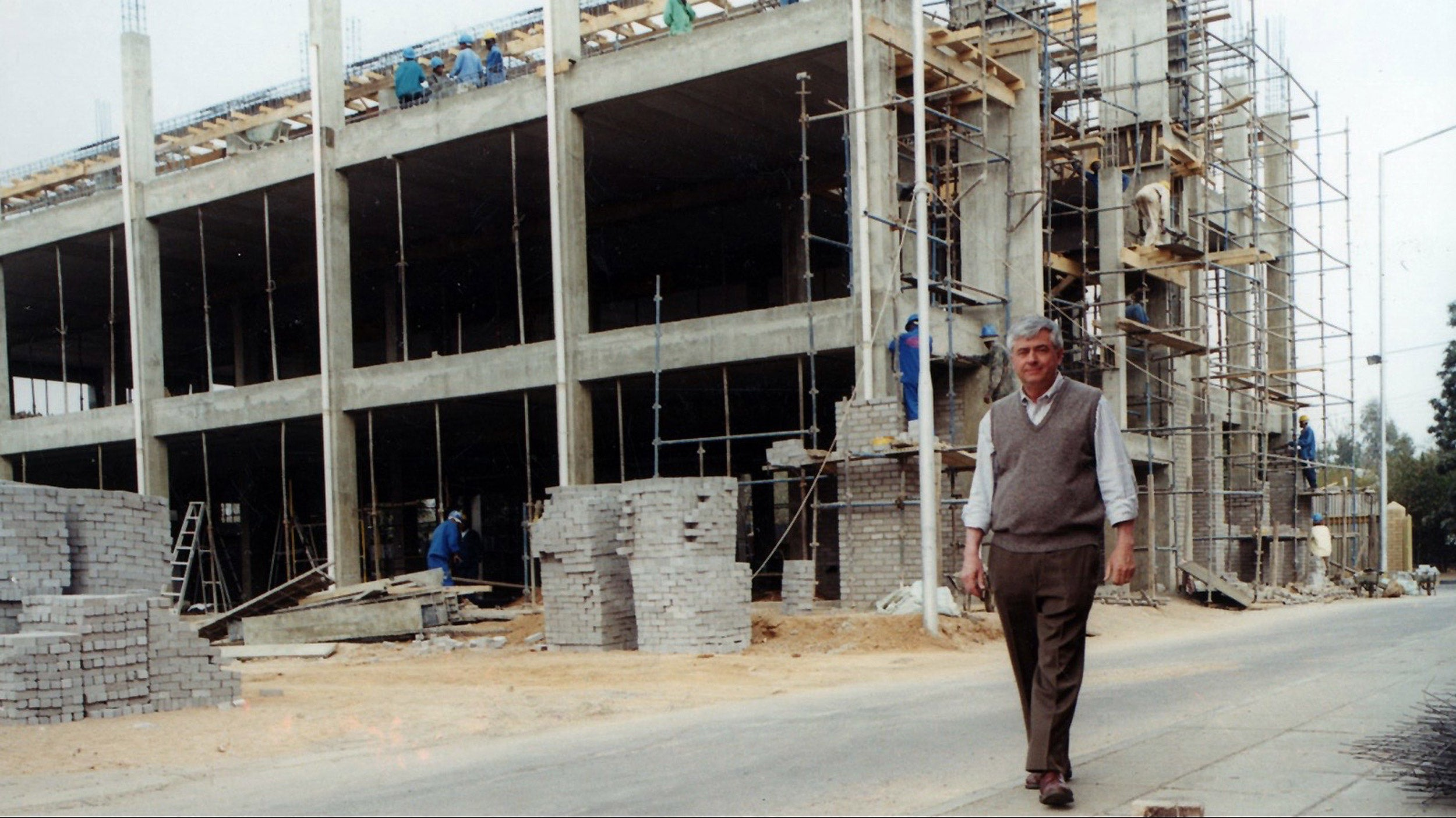 Max Essex walks past the Botswana-Harvard HIV Reference Laboratory under construction.