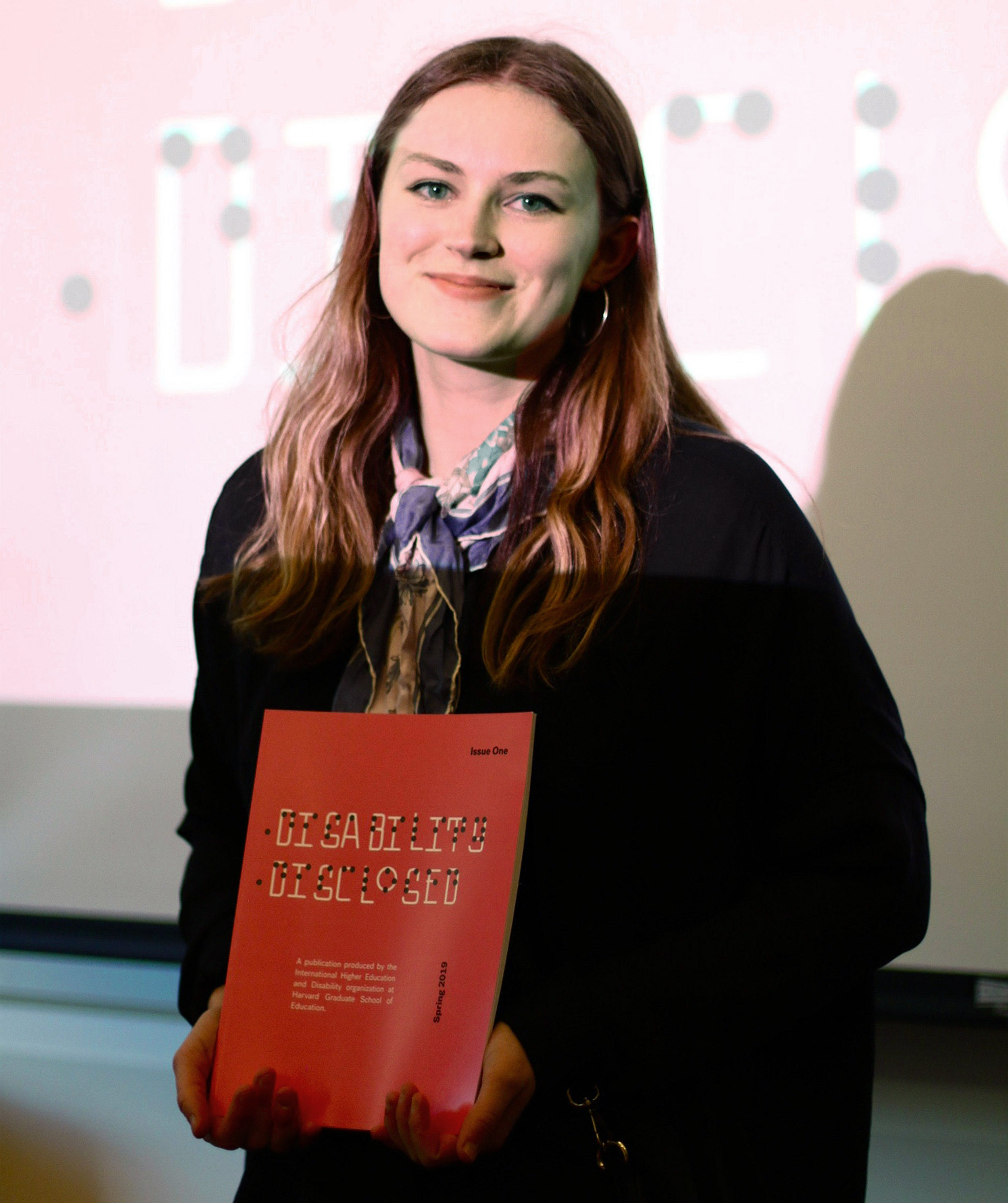 Nikita Andersson holding a copy of the journal.