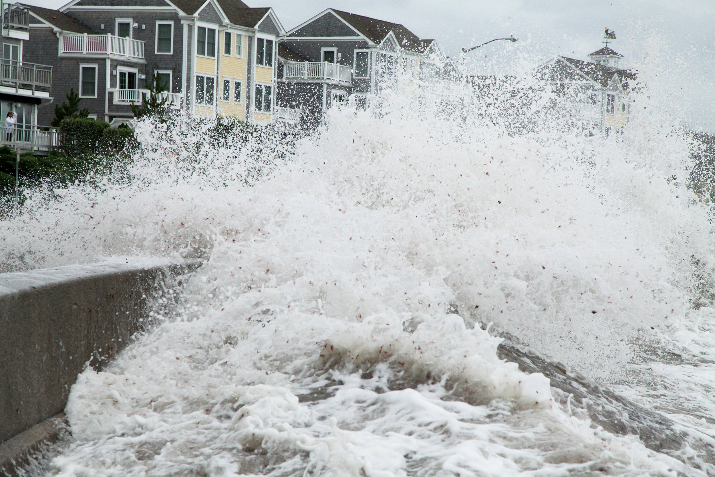 Storm surge hitting houses along coast.