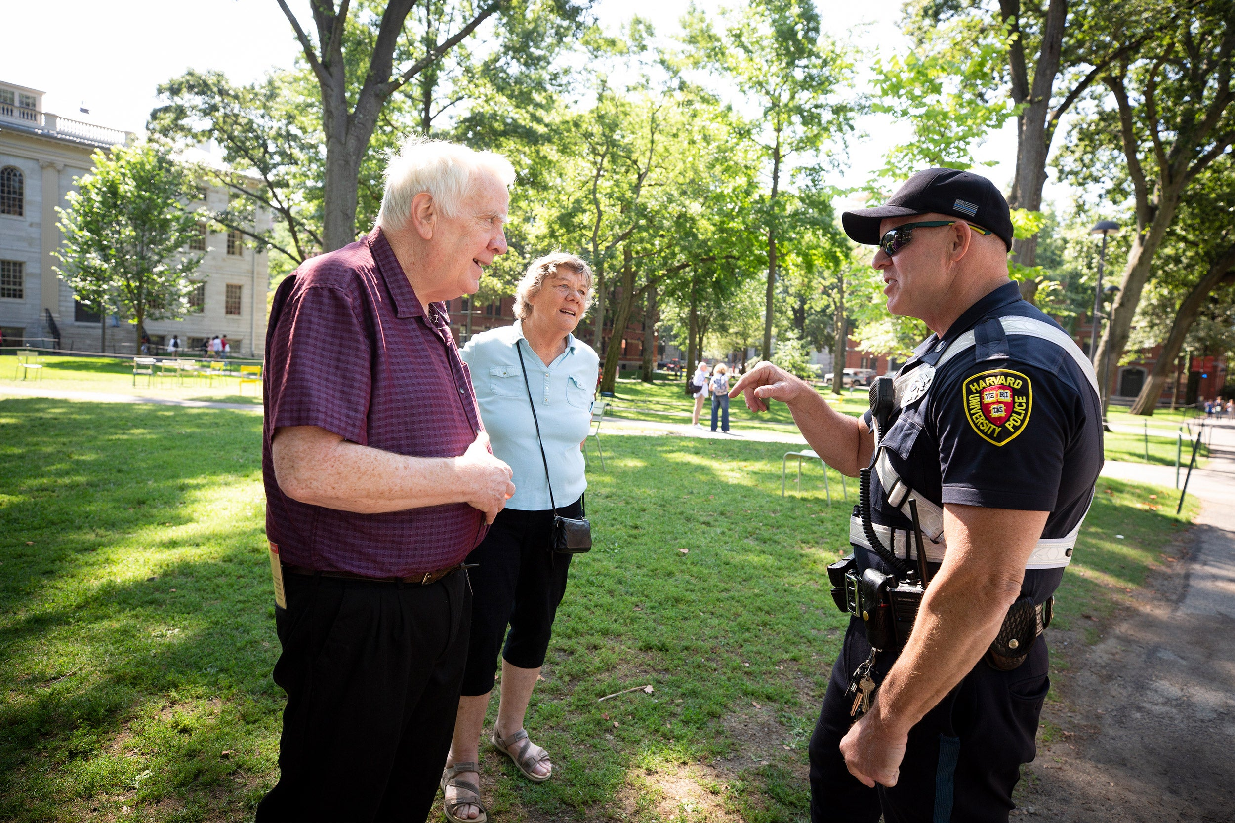 Older couple speaking to Harvard police officer